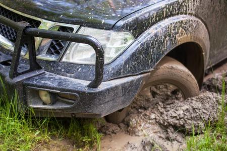 SUV got stuck in the mud, wheel closeup. Stock Photo