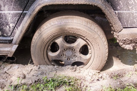 SUV got stuck in the mud, wheel closeup. Reklamní fotografie