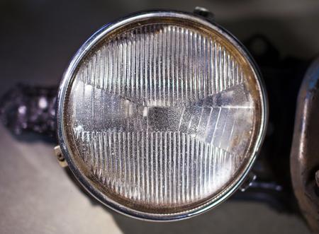 headlight: Closeup photo of old car headlight. Stock Photo
