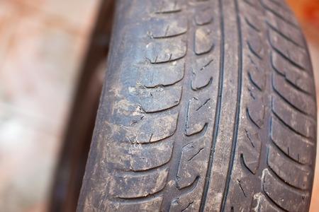pisar: Old car tire with erased tread. Foto de archivo
