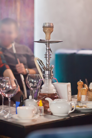 smoking pipe: The restaurants interior with hookah
