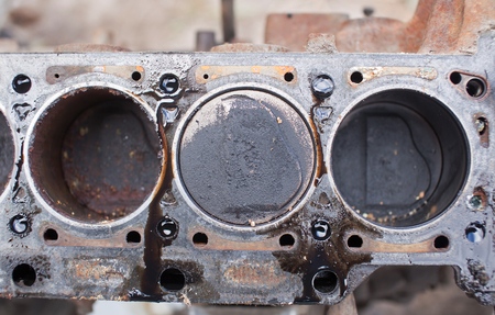 Old non-working engine with rusty pistons.