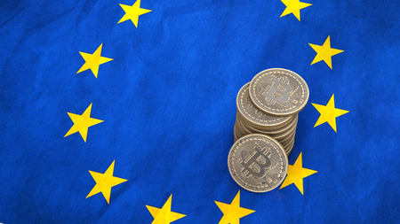 A pile of Bitcoin coins stands on the flag of European Union. 3D render Stock Photo