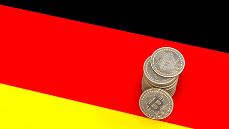 A pile of Bitcoin coins stands on the flag of German. 3D render. Stock Photo