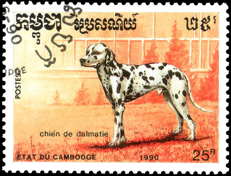 CAMBODIA - CIRCA 1990: postage stamp, printed in Cambodia, shows a Dalmatian dog Editorial
