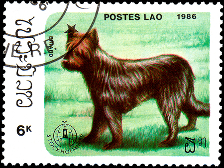LAOS - CIRCA 1986: postage stamp, printed in Laos, shows briard dog Stock fotó - 89238330