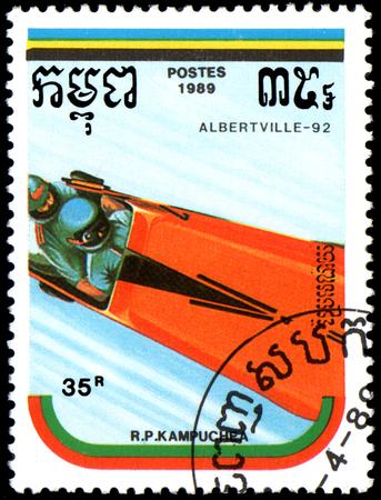 REPUBLIC OF KAMPUCHEA (CAMBODIA) - CIRCA 1989: postage stamp, printed in Republic of Kampuchea, shows a bobsled. Series Winter Olympic Games, Albertville, 1992 Editorial