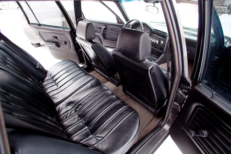 Black leather rear seats of retro car