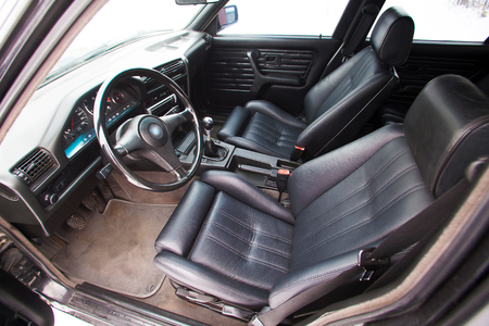 Black leather front seats of retro car