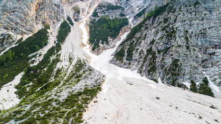 Aerial view of the mudflow with snow high in the Alpine mountains