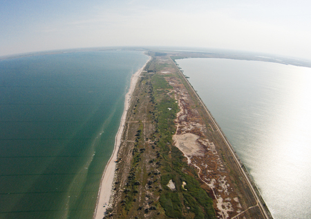 Aerial view of the spit that separates the sea and estuary.