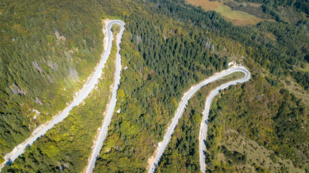 Aerial view of the movement of vehicles on a serpentine mountain road. Croatia. Zdjęcie Seryjne