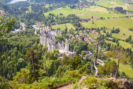 View from the air to the castle of Neuschwanstein  in the Alpine mountains. Standard-Bild