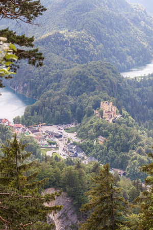 View from the air to the Schloss Hohenschwangau castle in the Alpine mountains. Standard-Bild