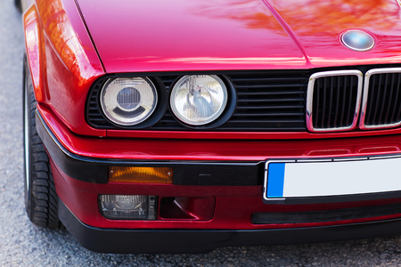 Headlights of a red, old, retro car, closeup. Imagens