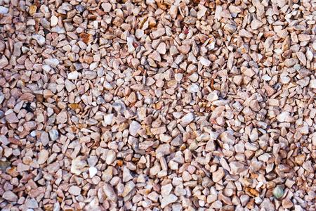 Beige gravel stone floor texture background