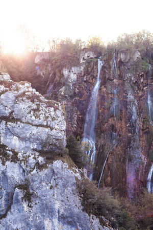Water that falls from a large waterfall over stone slopes, Plitvice Lakes.