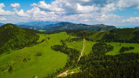 Aerial view of a mountain range with trees in the Tatra Mountains, Slovakia.