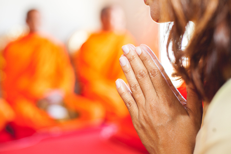 chant: The woman praying while religious ceremony with monk background