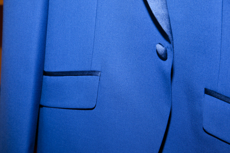 detail of the right pocket of an electric blue men jacket