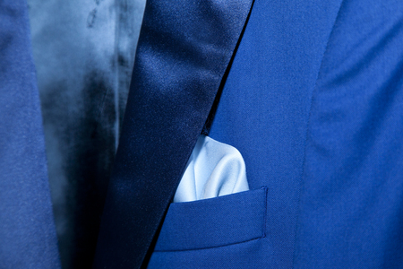 detail of the handkerchief of an electric blue-colored gentleman suit