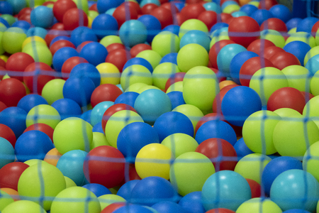 detail of the colorful balls of a playground.