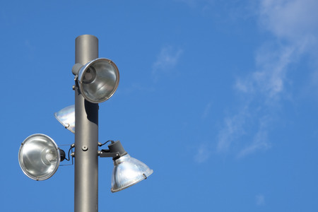 streetlight of the three lights and background a large blue sky with few clouds Stock Photo