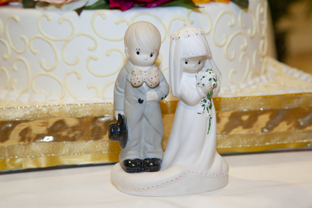 detail of the dolls of a wedding cake with a cake in the background Stock Photo