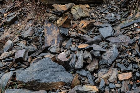 detail of a slate quarry, where you can see pieces of this rough stone