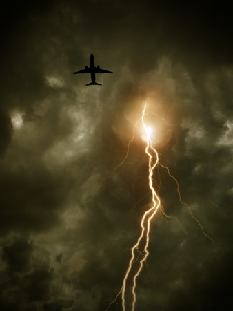 cloudy sky with lightning and plane
