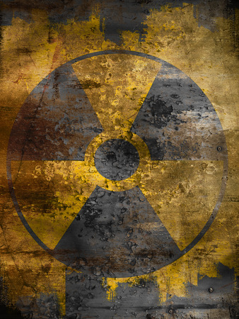 dirty yellow nuclear warning symbol photo
