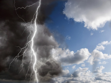 blue sunny sky and black clouds with lightning photo