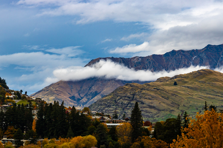Clouds rolling into Queenstown Stock Photo