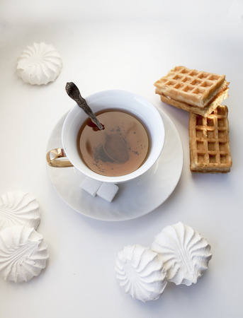 Tea with waffles and marshmallows photo