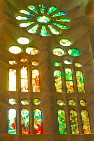 gothic build: Barcelona, Spain- September 18, 2014: Sagrada Familia by Antonio Gaudi, Stained-glass windows indoor Editorial