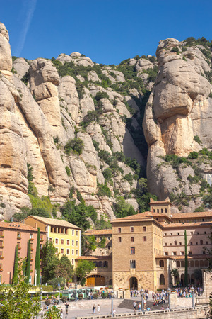 MONTSERRAT, SPAIN - SEPTEMBER 20, 2014: View of the Santa Maria Square and Monastery of Montserrat Editorial