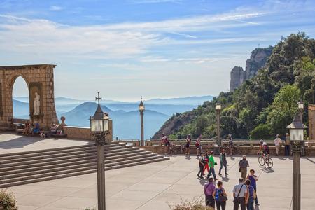 virgin of montserrat: MONTSERRAT, SPAIN - SEPTEMBER 20, 2014: Main square in front of Monastery entrance.