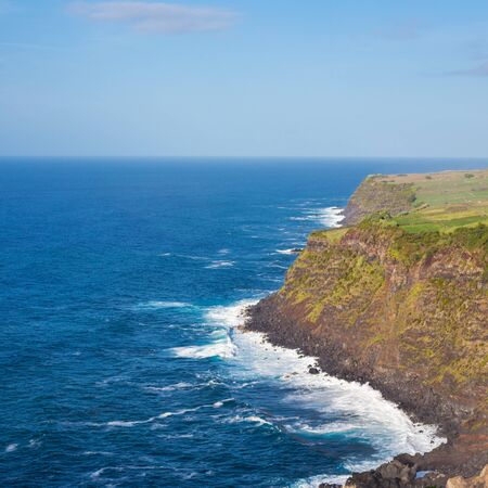 Cliffs and Atlantic ocean view from the observation deck Vigia das Baleias, Terceira. Beautiful rocks blue sky and sea. Azores, Portugal Stock fotó