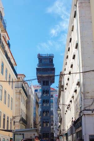Lisbon, Portugal - September 13, 2019: Elevador de Santa Justa Lift seen from Santa Justa Street. 19th century. By Raul Mesnier de Ponsard, a Gustave Eiffel disciple.