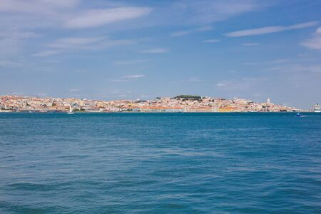 Lisbon on the Tagus river bank, central Portugal. Tajo view from the ferry to Almada. Taxo is the largest river of the Iberian Peninsula