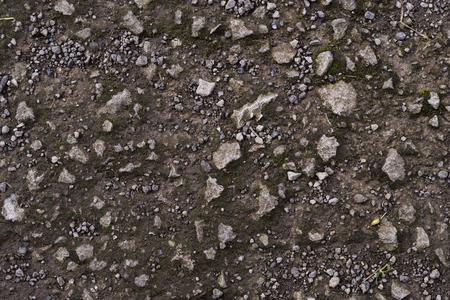 Een grijze en bruine steen en vuil aarde bodemtextuur Stockfoto - 93561325