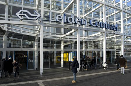 Leiden / The Netherlands - February 4 2018 The entrance to the train and bus station in Leiden with people walking in and out in a hurry.