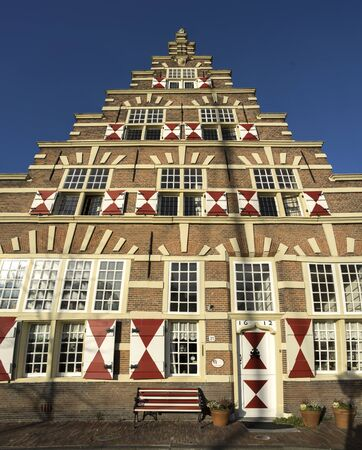a traditional vintage old dutch house with stepped rooftops and old vintage window shutters in Leiden Redactioneel