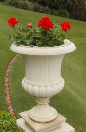 stone vase of flowers in the park Stock Photo - 17037920