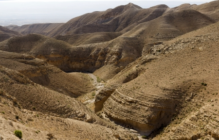 Desert canyon of Wadi Kelt in Israel photo