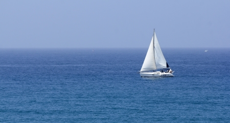 sea boat with white sails photo