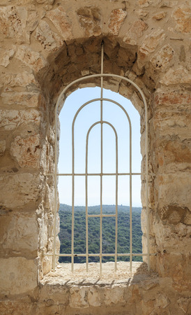 lattice window: window of an old fortress with a lattice