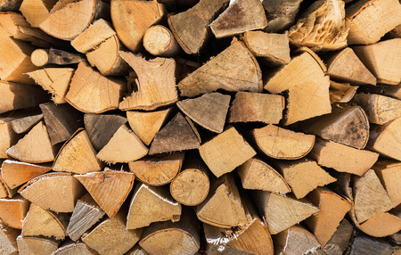 neatly stacked: neatly stacked firewood natural background