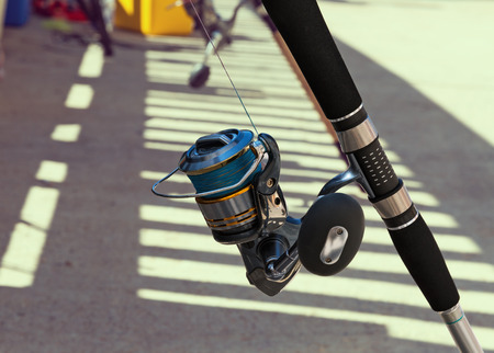 spinning reel: colorful spinning with reel for fishing close-up