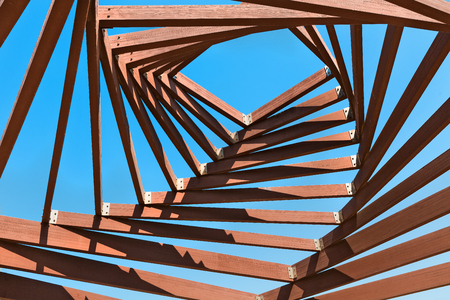 architectural feature: Wooden pergola design against the blue sky